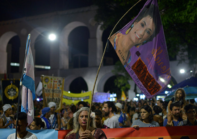 Demonstrators protest about the assassination of Rio de Janeiro city councillor Marielle Franco