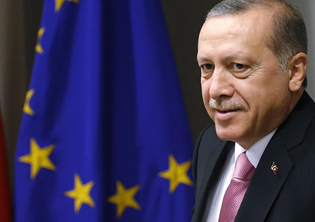 Turkish President Recep Tayyip Erdogan waits for the arrival of European Council President Donald Tusk prior to a meeting at the EU Council building in Brussels on Monday, Oct. 5, 2015.