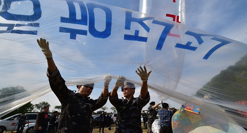 (File) South Korean activists fill gas into a large balloon to launch anti-Pyongyang leaflets into the air at a field near the Demilitarized zone dividing the two Koreas in the border city of Paju on April 29, 2016