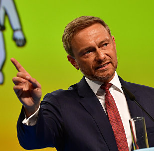 Christian Lindner, chairman of Germany's liberal Free Democratic Party (FDP), makes a point during his speech at a party congress in Berlin on May 12, 2018