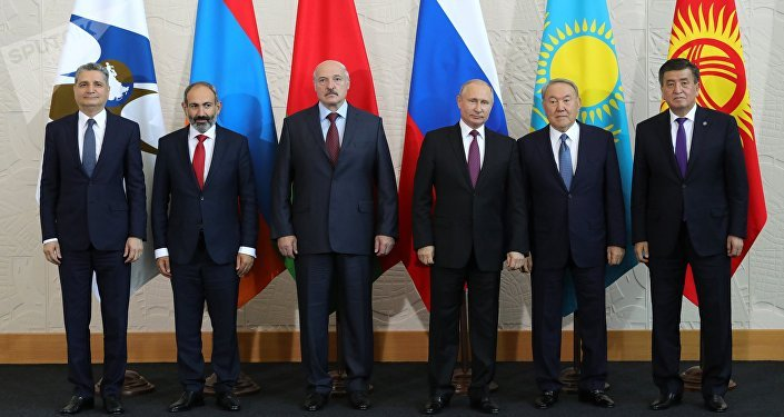 Russian President Vladimir Putin during a joint photo session before a meeting of the Supreme Eurasian Economic Council in Sochi