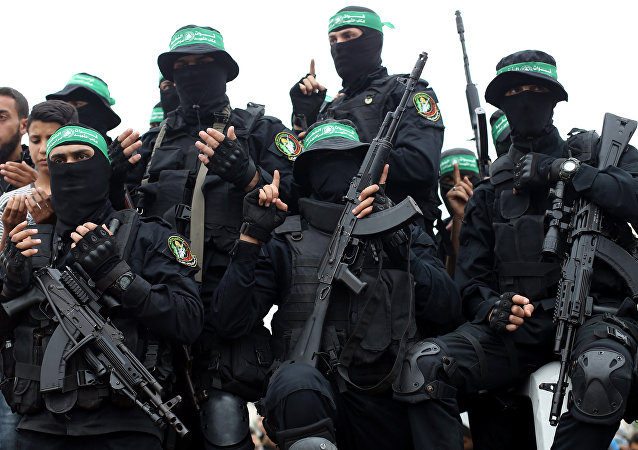 Palestinian Hamas militants attend the funeral of their comrades who were killed in an explosion, in the central Gaza Strip May 6, 2018