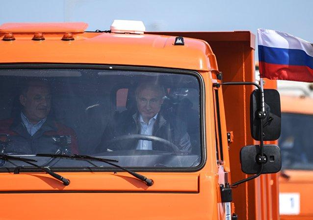 Russian President Vladimir Putin drives a Kamaz truck on the newly opened motor road section of the Kerch Strait (Crimean) Bridge