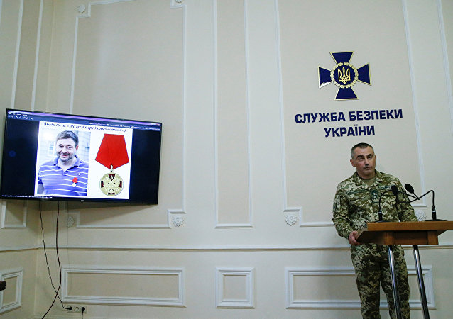 A portrait of the director of Kiev's office of Russian state news agency RIA Novosti Kirill Vyshinsky is seen on a monitor during a news briefing at the headquarter of the Ukrainian State Security Service in Kiev, Ukraine May 15, 2018