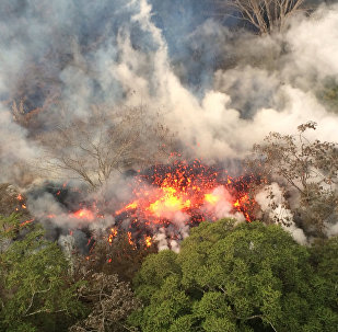 This Wednesday, May 16, 2018, image provided by the U.S. Geological Survey shows lava spattering from an area between active Fissures 16 and 20 photographed at 8:20 a.m. HST, on the lower east rift of the Kilauea volcano, near Pahoa, Hawaii