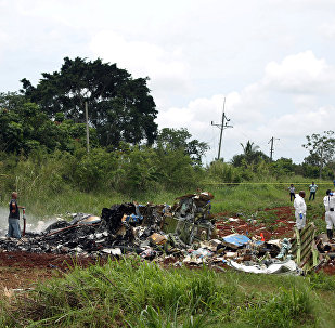 Rescue team members work in the wreckage of a Boeing 737 plane that crashed in the agricultural area of Boyeros, around 20 km (12 miles) south of Havana, shortly after taking off from Havana's main airport in Cuba, May 18, 2018.