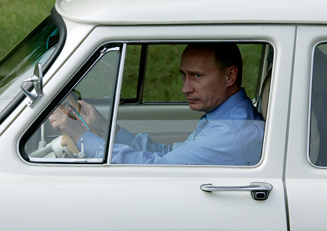 Russian President Vladimir Putin driving a GAZ-21 Volga 1956 to the opening of a new tunnel, Adler-Krasnaya Polyana