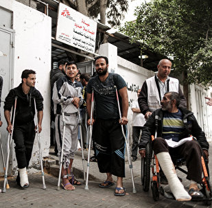 Palestinians, wounded in previous weeks during mass protests against Israeli forces along the border of the Palestinian enclave, dubbed The Great March of Return, await medical check-up at the Doctors Without Borders (MSF) clinic in Gaza City (File)