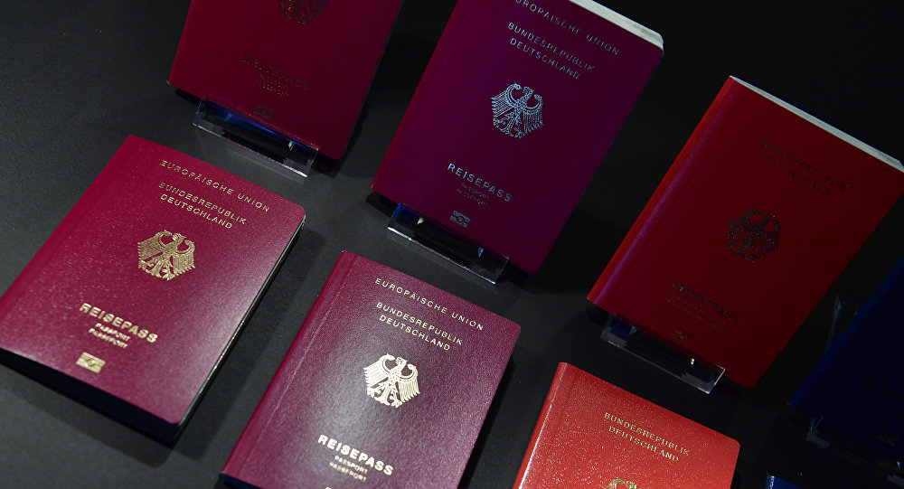 The new German electronic passport is presented during an official press conference on February 23, 2017 in Berlin