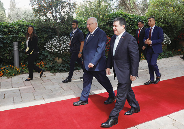 Paraguayan President Horacio Cartes walks next to Israeli President Reuven Rivlin upon his arrival for a meeting at the Israeli president's residence in Jerusalem, ahead of the dedication ceremony of the embassy of Paraguay in Jerusalem, May 21, 2018