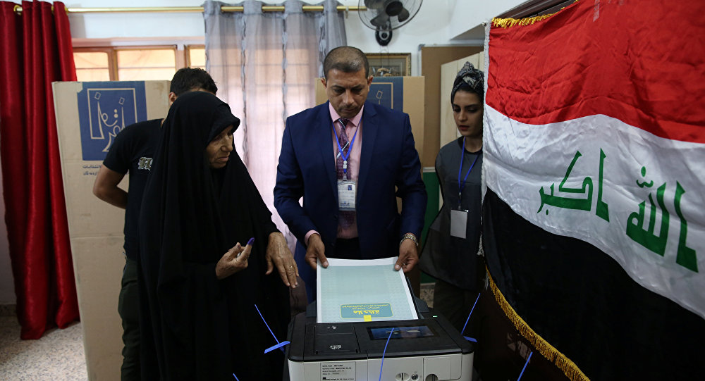 An Iraqi woman casts her vote at a polling station during the parliamentary election in Baghdad, Iraq May 12, 2018