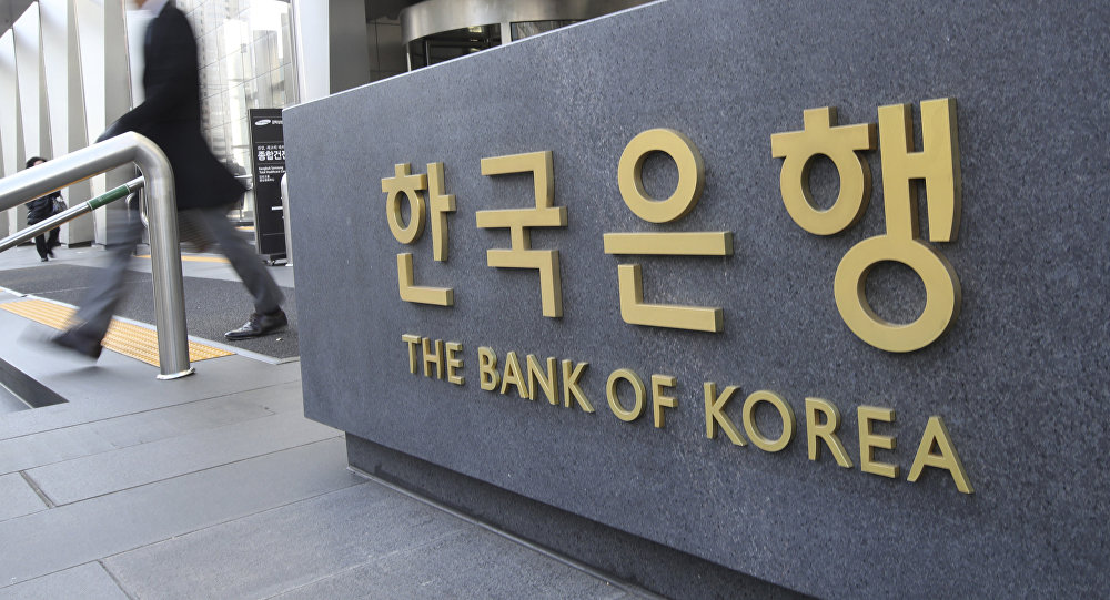 A man walks by the sign of the Bank of Korea in Seoul, South Korea, Thursday, Nov. 30, 2017