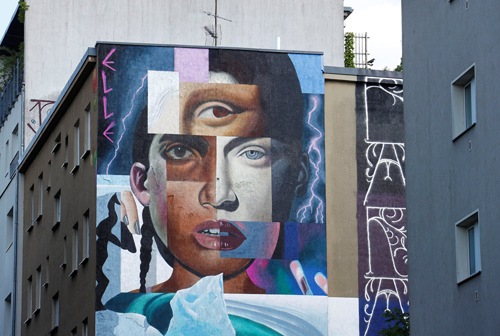 Artwork by urban artist 'Elle' is pictured as part of the first Berlin Mural Fest 2018
