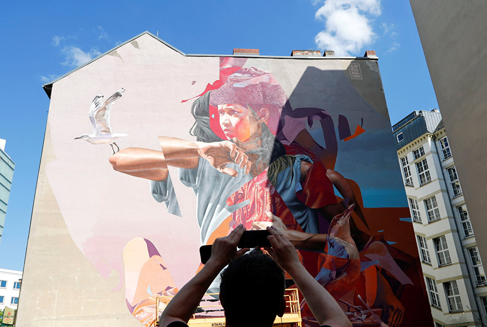 Artwork of urban artists TelmoMiel and James Bullough is pictured as part of the first Berlin Mural Fest 2018