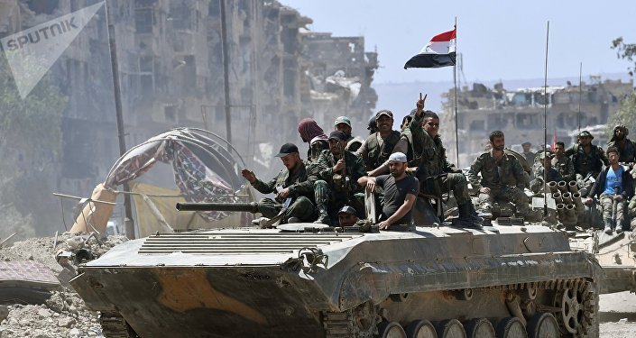 Service personnel of the Syrian Army on a BMD-1 in the liberated Palestinian refugee camp of Yarmouk south of Damascus