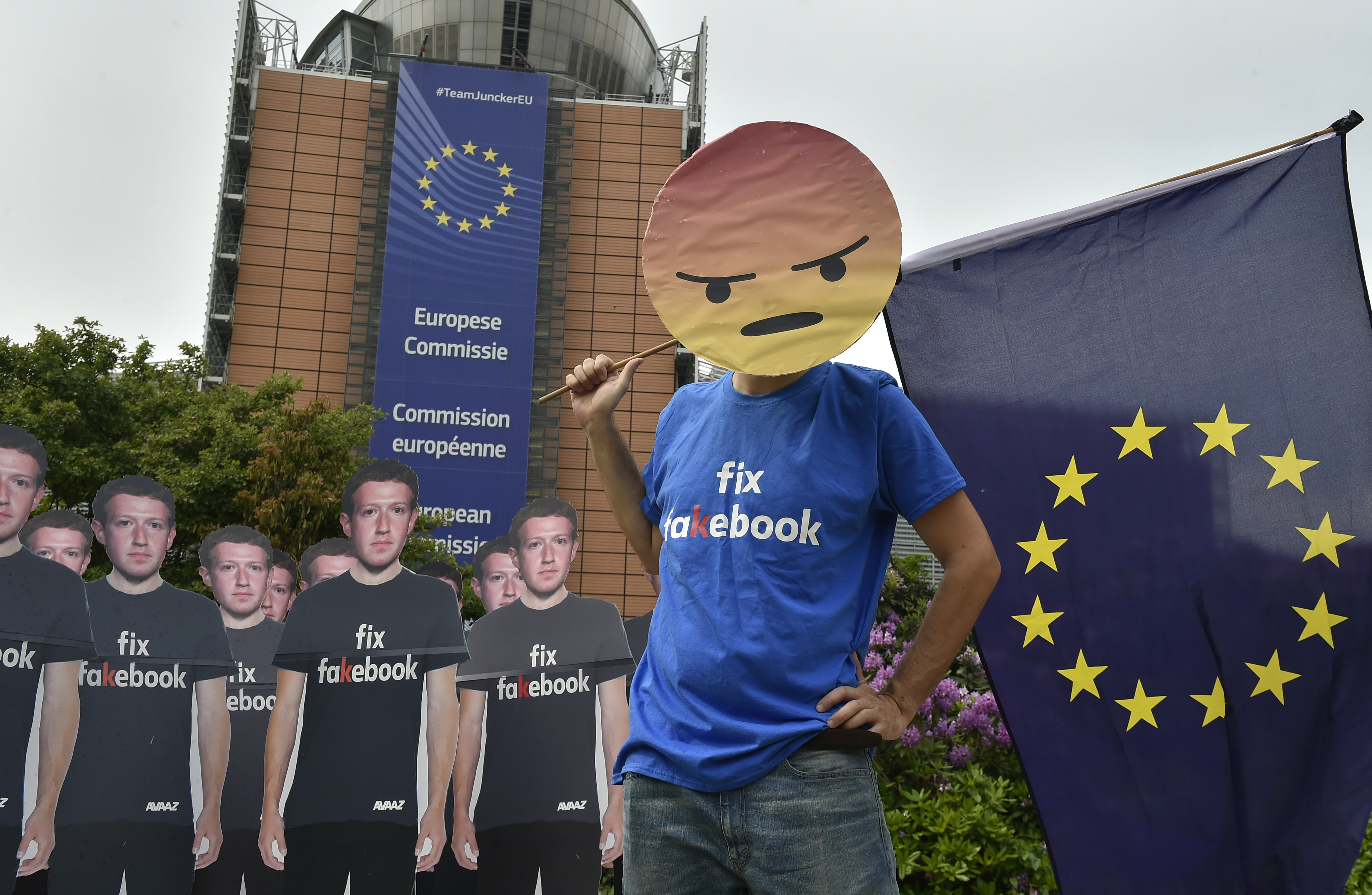 Global activists of Avaaz, set up cardboard cutouts of Facebook chief Mark Zuckerberg, on which is written Fix Fakebook, in front of the European Union headquarters in Brussels, on May 22, 2018, as they call attention to what the groups says are hundreds of millions of fake accounts still spreading disinformation on Facebook.