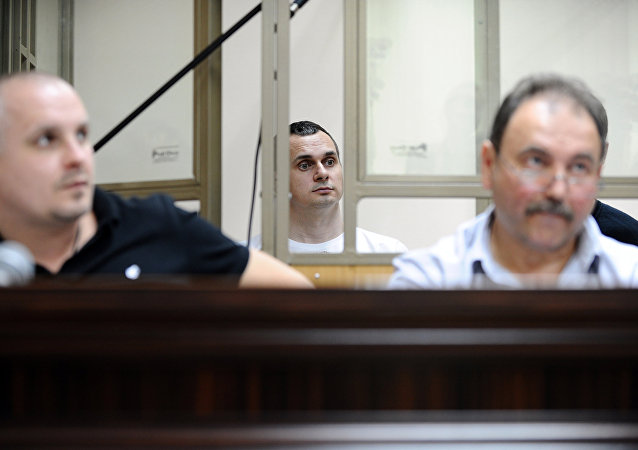 The Ukrainian film-maker Oleg Sentsov (center) seen in the North-Caucasian District Military courtroom, Rostov-on-Don, the venue of initial hearings on the acts of terrorism in Crimea