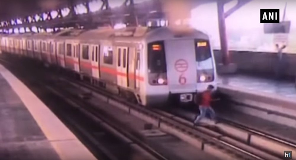 Watch video: Man crosses tracks at Delhi Metro station as train starts moving