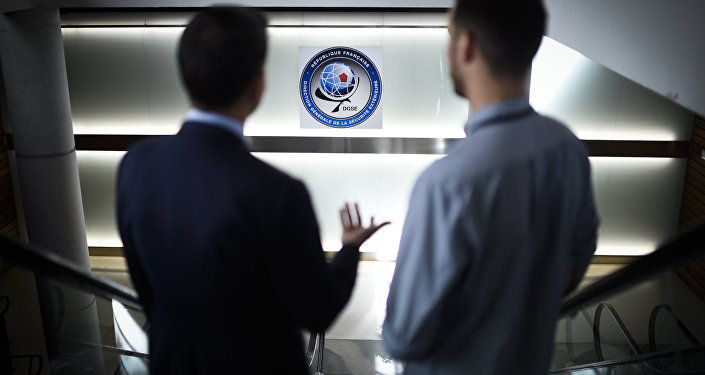 Two men pose at the headquarters of the General Directorate for External Security (DGSE), France's external intelligence agency, in Paris on June 4, 2015