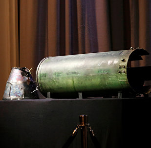 A damaged missile is displayed during a news conference by members of the Joint Investigation Team, comprising the authorities from Australia, Belgium, Malaysia, the Netherlands and Ukraine, who present interim results in the ongoing investigation of the 2014 MH17 crash that killed 298 people over eastern Ukraine, in Bunnik, Netherlands, May 24, 2018