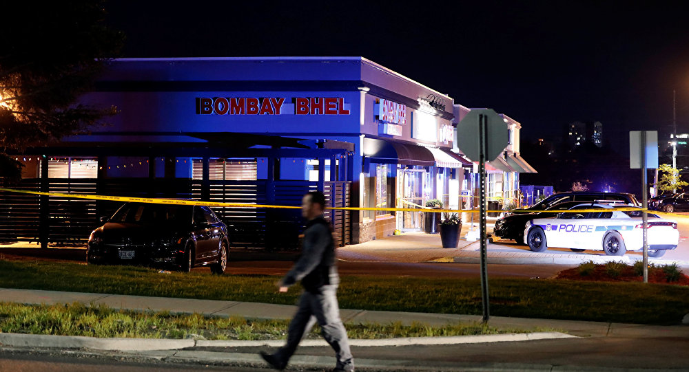 A police officer walks in front of Bombay Bhel restaurant, where two unidentified men set off a bomb late Thursday night, wounding more than a dozen people, in Mississauga, Ontario, Canada May 25, 2018