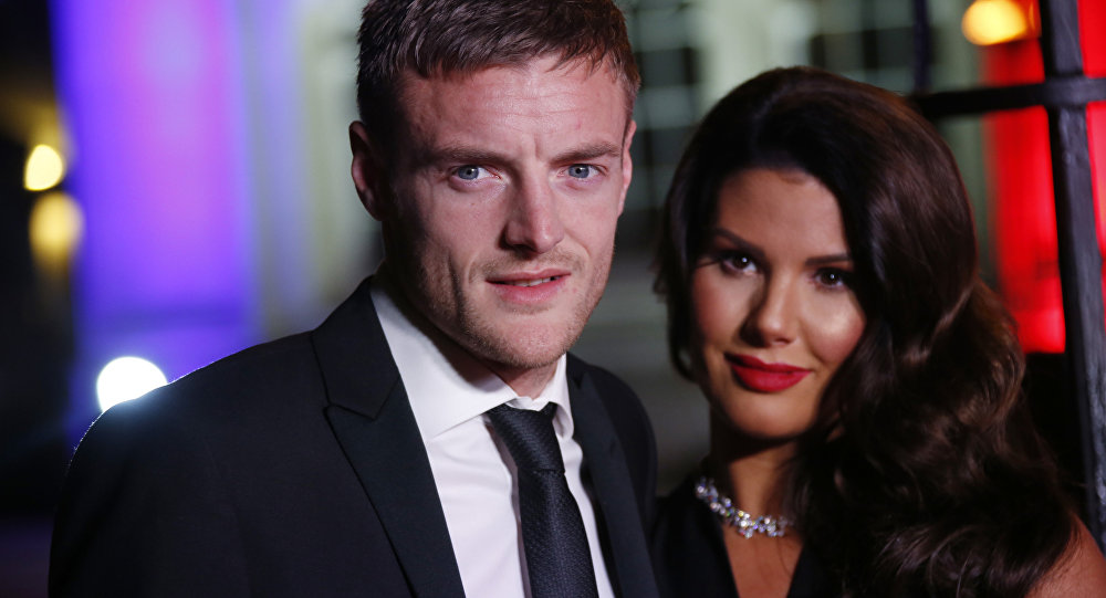 Jamie Vardy and Rebekah Vardy pose for photographers upon arrival at The Sun Military Awards 2016 in London, Wednesday, Dec. 14, 2016
