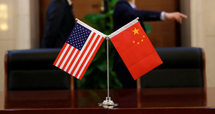 Chinese and U.S. flags are set up for a signing ceremony during a visit by U.S. Secretary of Transportation Elaine Chao at China's Ministry of Transport in Beijing, China April 27, 2018