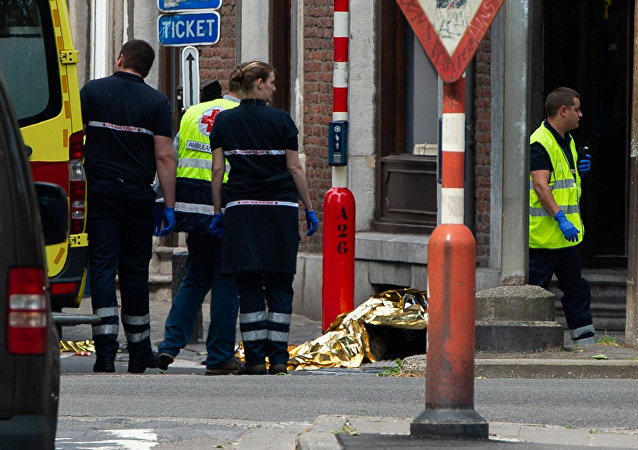 Rescuers are seen following a shooting in Liege, Belgium, May 29, 2018