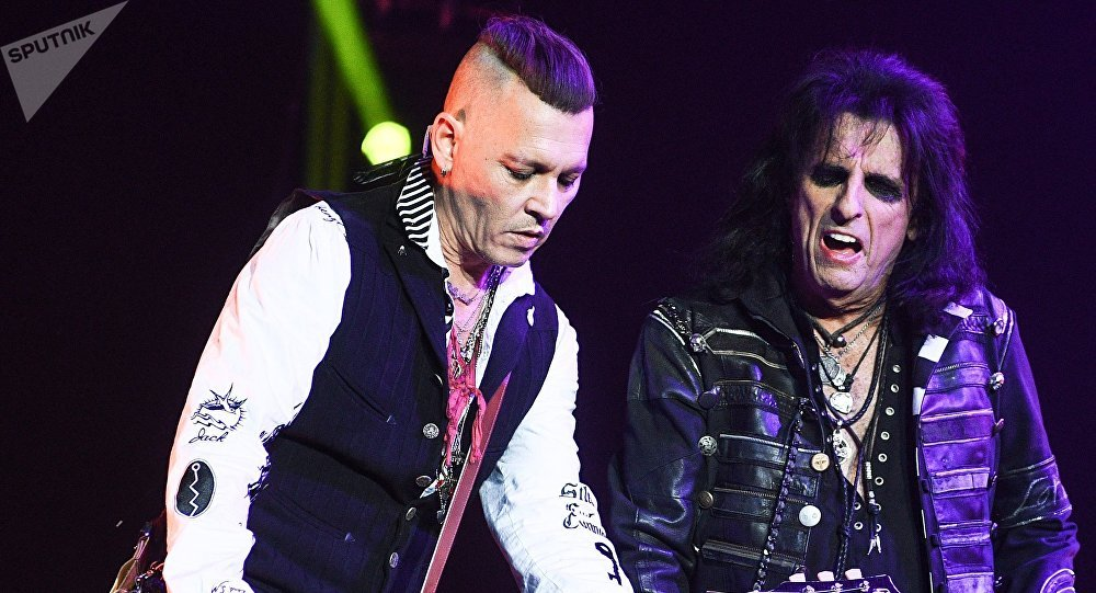 Actor Johnny Depp, left, and American rock musician Alice Cooper during a performance at the Olimpiysky sports complex