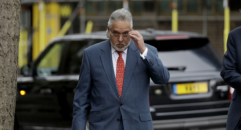 F1 Force India team boss Vijay Mallya arrives for a hearing for his extradition case at Westminster Magistrates Court in London, Friday, April 27, 2018