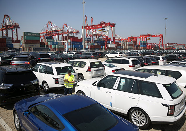 A worker inspects imported cars at a port in Qingdao, Shandong province, China May 23, 2018