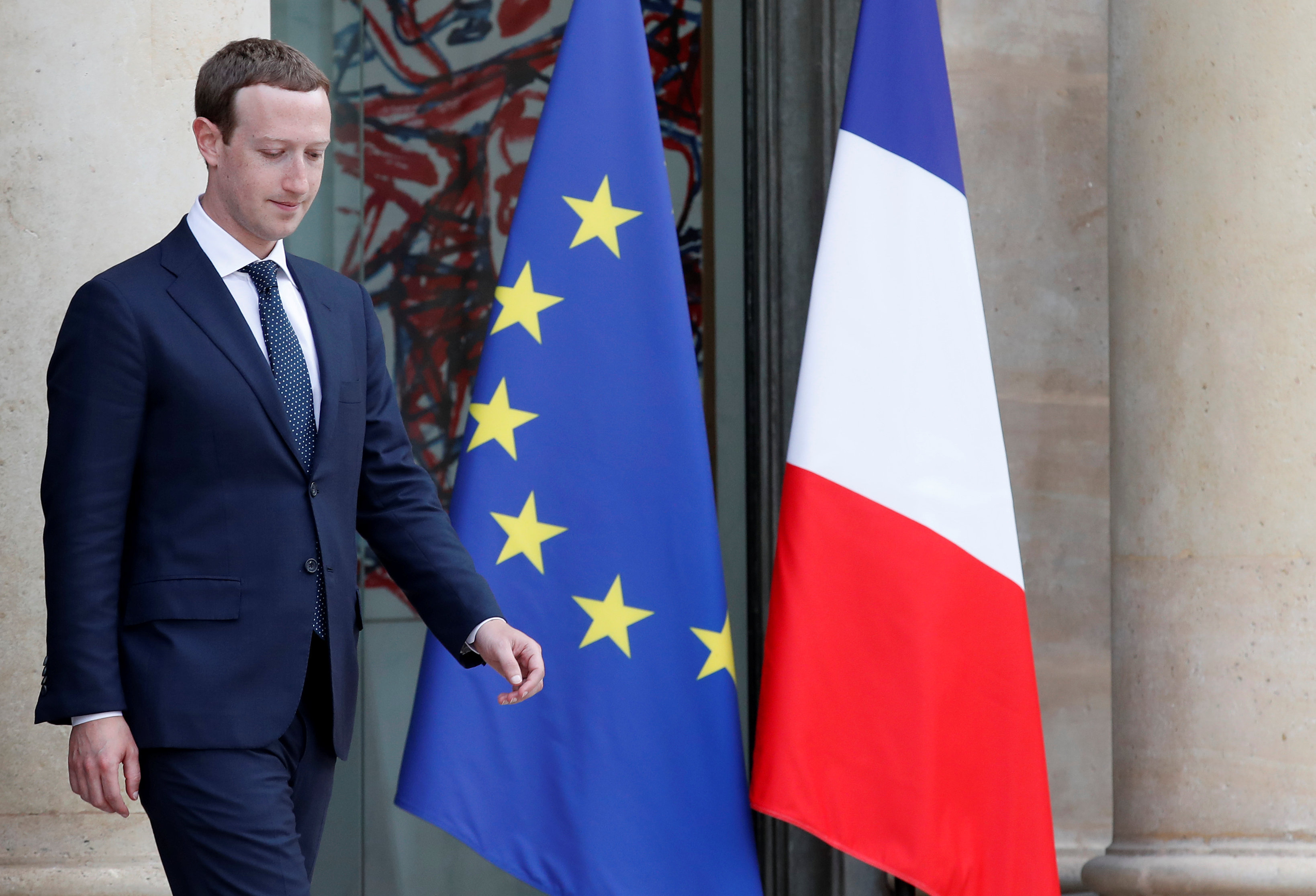 Facebook's CEO Mark Zuckerberg leaves after a meeting with French President at the Elysee Palace in Paris