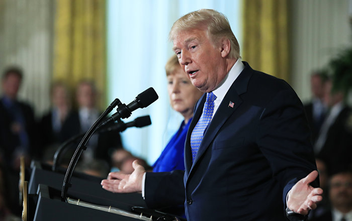 President Donald Trump with German Chancellor Angela Merkel speaks during a news conference in the East Room of the White House in Washington, Friday, April 27, 2018