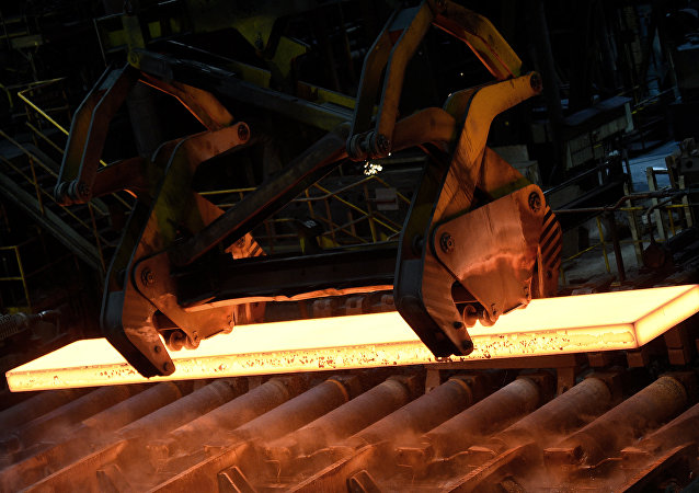 Steel is moved by a steel-worker in a mill at the plant of German steel company Salzgitter AG in Salzgitter, Lower Saxony on March 3, 2016