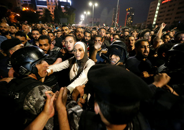 Demonstrators clash with riot police during a protest in Amman, Jordan, June 2, 2018