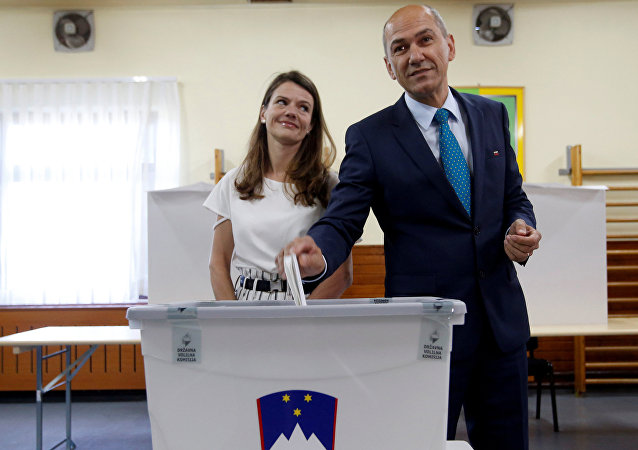 Janez Jansa, leader of the Social Democratic Party (SDS), and his wife Urska cast their votes at a polling station during the general election in Velenje, Slovenia, June 3, 2018.