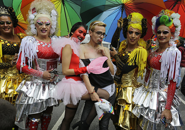 Revelers in costume attend the annual gay pride parade in Sao Paulo, Brazil, Sunday, June 3, 2018