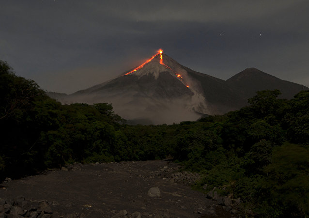 In this image taken with a long exposure, the Volcan de Fuego, or Volcano of Fire, spews hot molten lava from its crater in San Juan Alotenango, Guatemala, Wednesday, July 1, 2015
