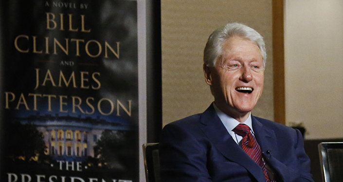 In this Monday, May 21, 2018 photo, former President Bill Clinton speaks during an interview about a novel he wrote with James Patterson, The President is Missing, in New York