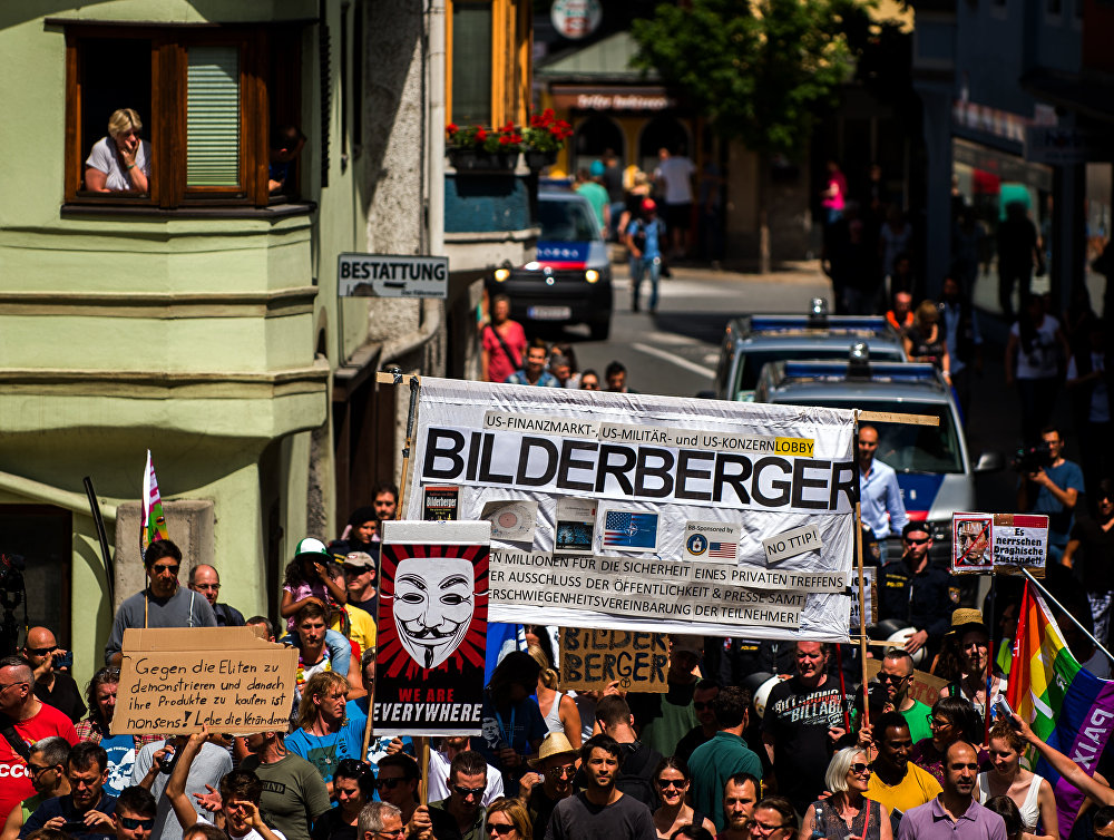 Protesters take part in a demonstration against the Bilderberg conference in Telfs, Austria, on June 13, 2015.