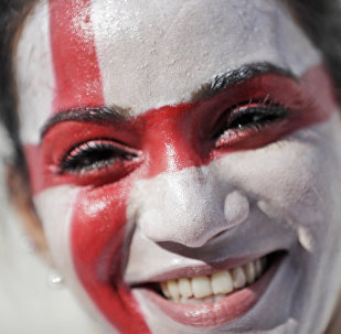 An English soccer fan smiles as she enters the Velodrome stadium ahead of the Euro 2016 Group B soccer match between England and Russia, in Marseille, France, Saturday, June 11, 2016.