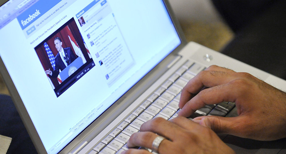 Muslim American Zabie Mansoory, 23, monitors a Facebook discussion board while watching President Barack Obama's televised coverage of President Barack Obama's speech from Cairo University, in the Sylmar area of Los Angeles, early Thursday June 4, 2009.