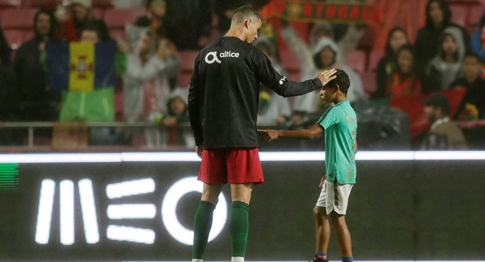 Soccer Football - International Friendly - Portugal vs Algeria - Estadio da Luz, Lisbon, Portugal - June 7, 2018 Portugal's Cristiano Ronaldo with his son after the match