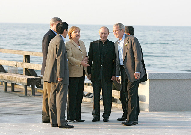 Right to left: U.S. President George W. Bush, Russian President Vladimir Putin and German Chancellor Angela Merkel out for a walk in Heiligendamm. June 7, 2007. File photo