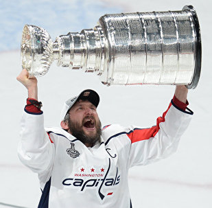 Jun 7, 2018; Las Vegas, NV, USA; Washington Capitals left wing Alex Ovechkin (8) hoists the Stanley Cup after defeating the Vegas Golden Knights in game five of the 2018 Stanley Cup Final at T-Mobile Arena