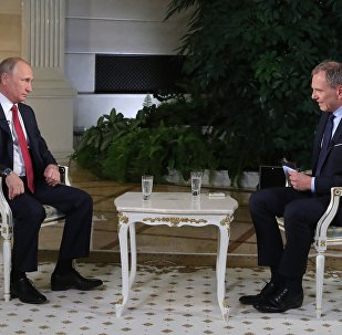 Russian President Vladimir Putin during an interview with Armin Wolf, right, a journalist of the Austrian ORF TV and radio company, at the Kremlin