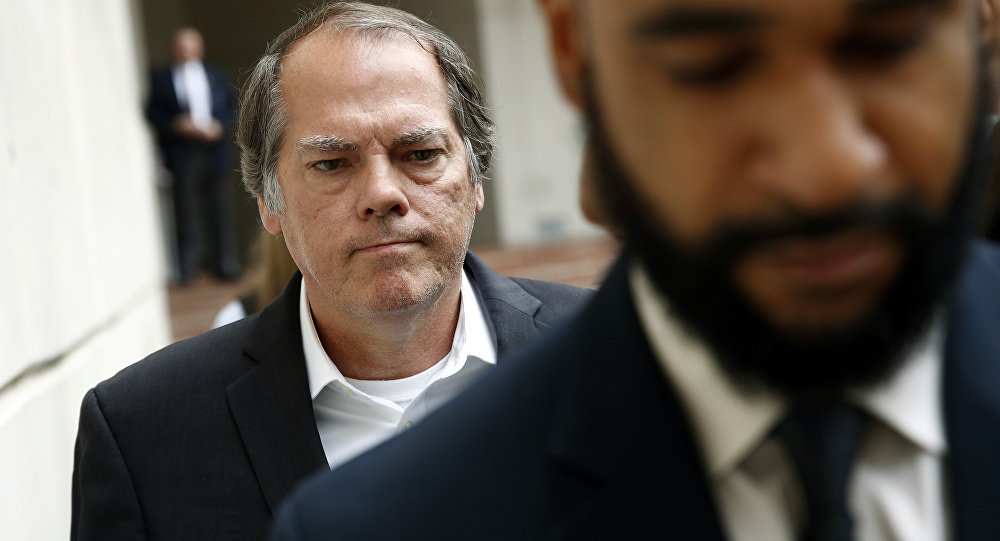 James Wolfe, former director of security with the U.S. Senate Intelligence Committee, departs a federal courthouse after a hearing, Friday, June 8, 2018, in Baltimore.