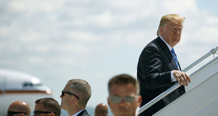 President Donald Trump boards Air Force One for a trip to Singapore to meet with North Korean leader Kim Jong Un, Saturday, June 9, 2018, at Canadian Forces Base Bagotville, in Canada.
