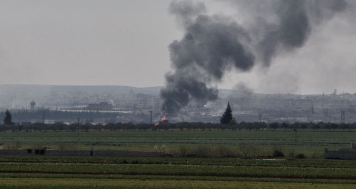Smoke rises from the northwestern Syrian city of Idlib on March 26, 2015 following bombing by rebels. Islamist fighters have seized 17 checkpoints from Syrian forces in clashes around the city of Idlib that have cost at least 71 lives, according to the Syrian Observatory for Human Rights.