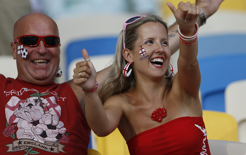 English fans cheer as they wait for the kick-off of the Euro 2012 soccer championship quarterfinal match between England and Italy in Kiev, Ukraine, Sunday, June 24, 2012.